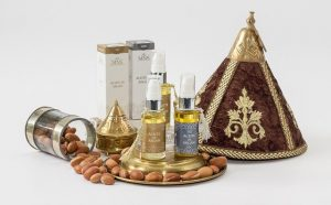 argan oil bottles with argan seeds and packaging around
