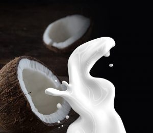 coconut milk out of a coconut shell