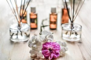 Essential oils with some flowers on the front in a relaxing vibe