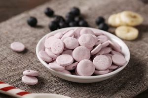 Food supplement in light pink color in a bowl
