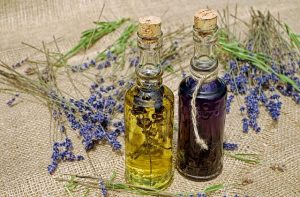 Lavender oil bottles with lavender strings around it