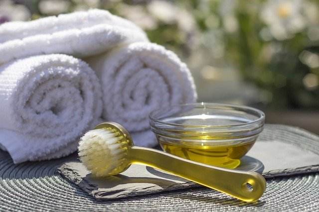 Prickly pear oil in a bowl next to a brush and towels