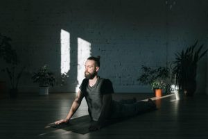 A man doing yoga in a relaxing atmosphere