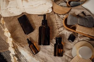 Unlabeled bottles of cosmetics shampoo or hair oil