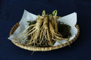 Korean ginseng roots on a plate with powder